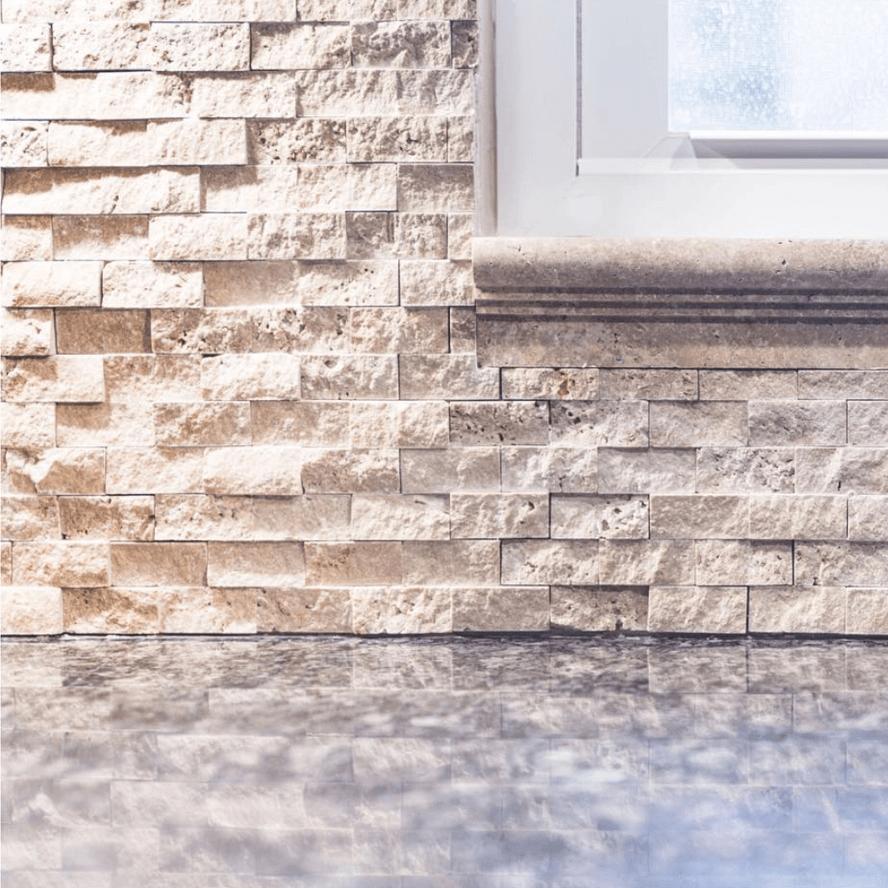 stacked stone rustic kitchen backsplash